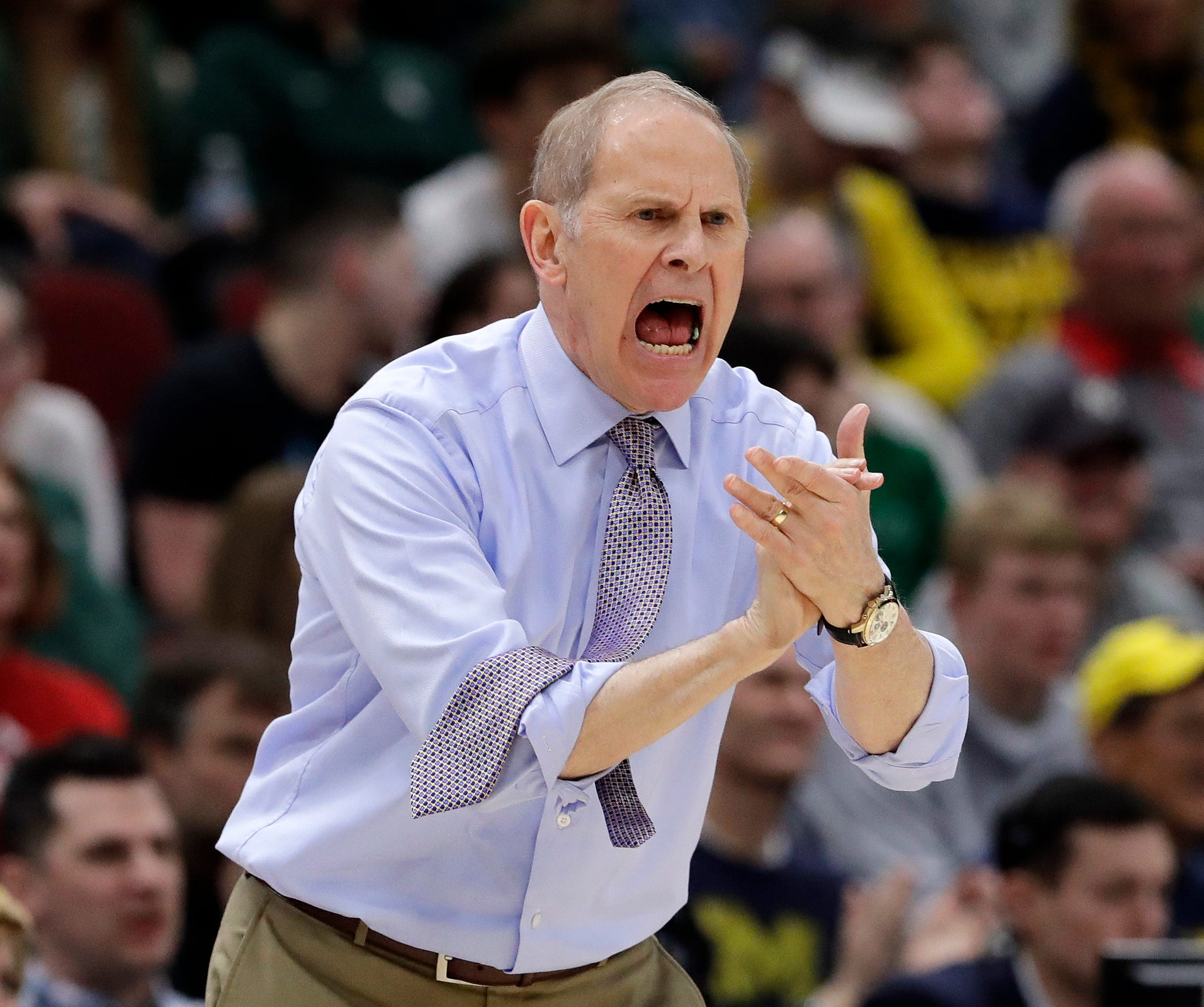 Michigan head coach John Beilein directs his team during the first half of an NCAA college basketball game against Minnesota in the semifinals of the Big Ten Conference tournament, Saturday, March 16, 2019, in Chicago.