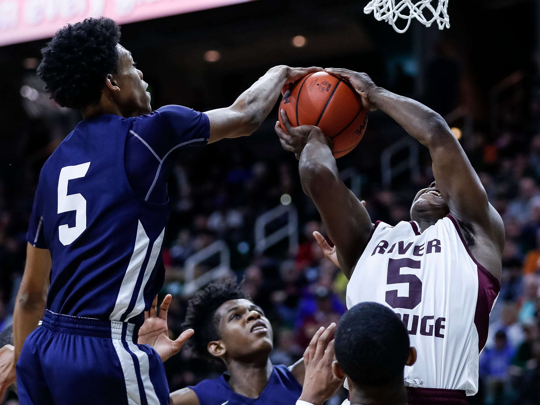 Harper Woods Chandler Park's Tyland Tate (5) block a layup from River Rouge's Jason Norton (5) during the first half of MHSAA Division 2 semifinal at the Breslin Center in East Lansing, Friday, March 15, 2019.