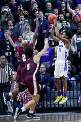 Ypsilanti Lincoln's Jalen Fisher hit a buzzer-beater as time expired to beat U-D Jesuit in the Division 1 title game.
