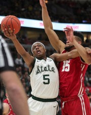 Michigan State guard Cassius Winston drives against Wisconsin forward Charles Thomas during the second half of MSU's 67-55 win in the Big Ten tournament semifinal Saturday, March 16, 2019 at the United Center in Chicago, Ill.