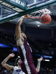U-D Jesuit's Daniel Friday (0) dunks against Ypsilanti Lincoln during the second half of MHSAA Division 1 final at the Breslin Center in East Lansing, Saturday, March 16, 2019.