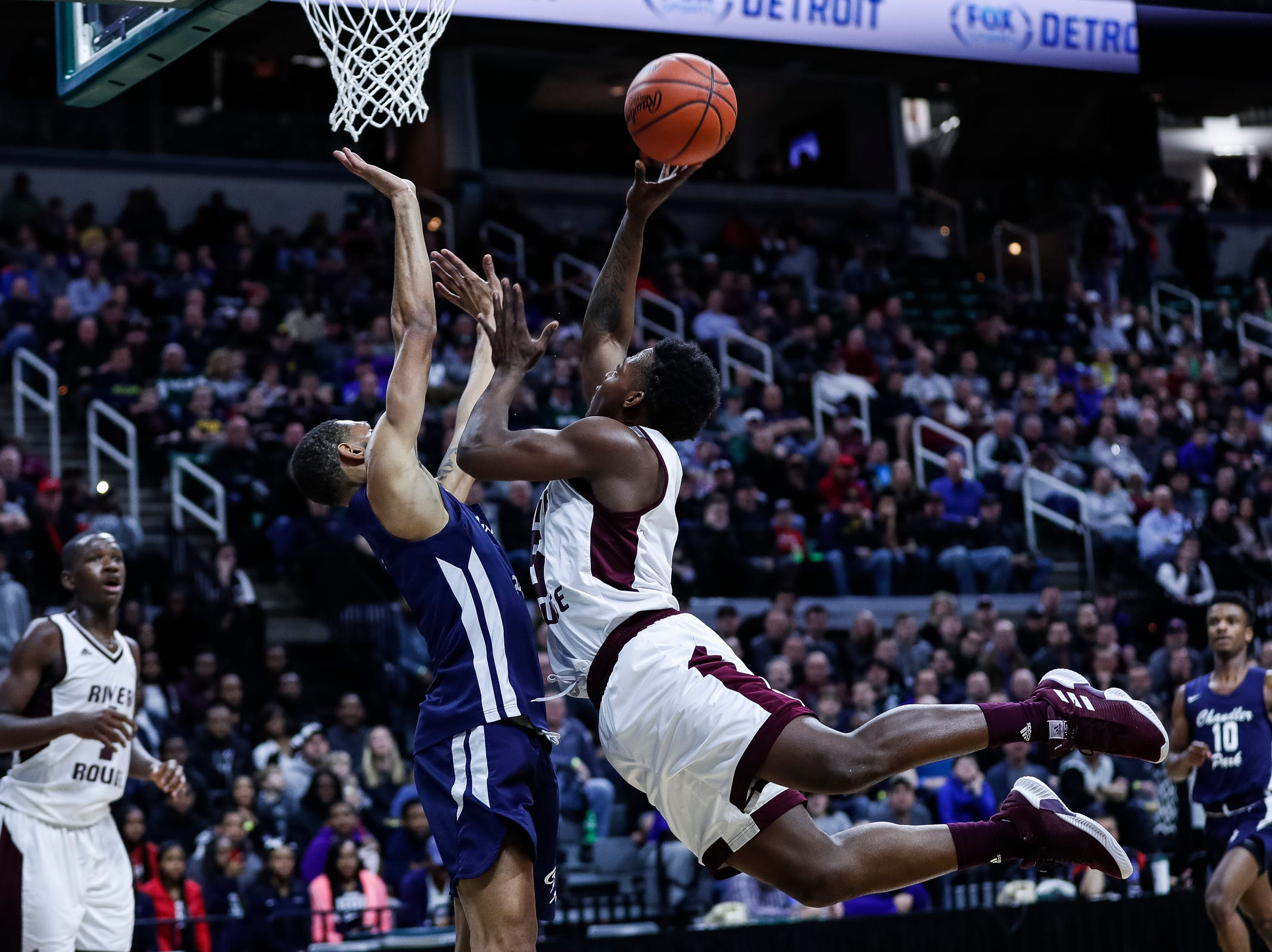 River Rouge's Jason Norton (5) makes a layup against Harper Woods Chandler Park during the first half of MHSAA Division 2 semifinal at the Breslin Center in East Lansing, Friday, March 15, 2019.