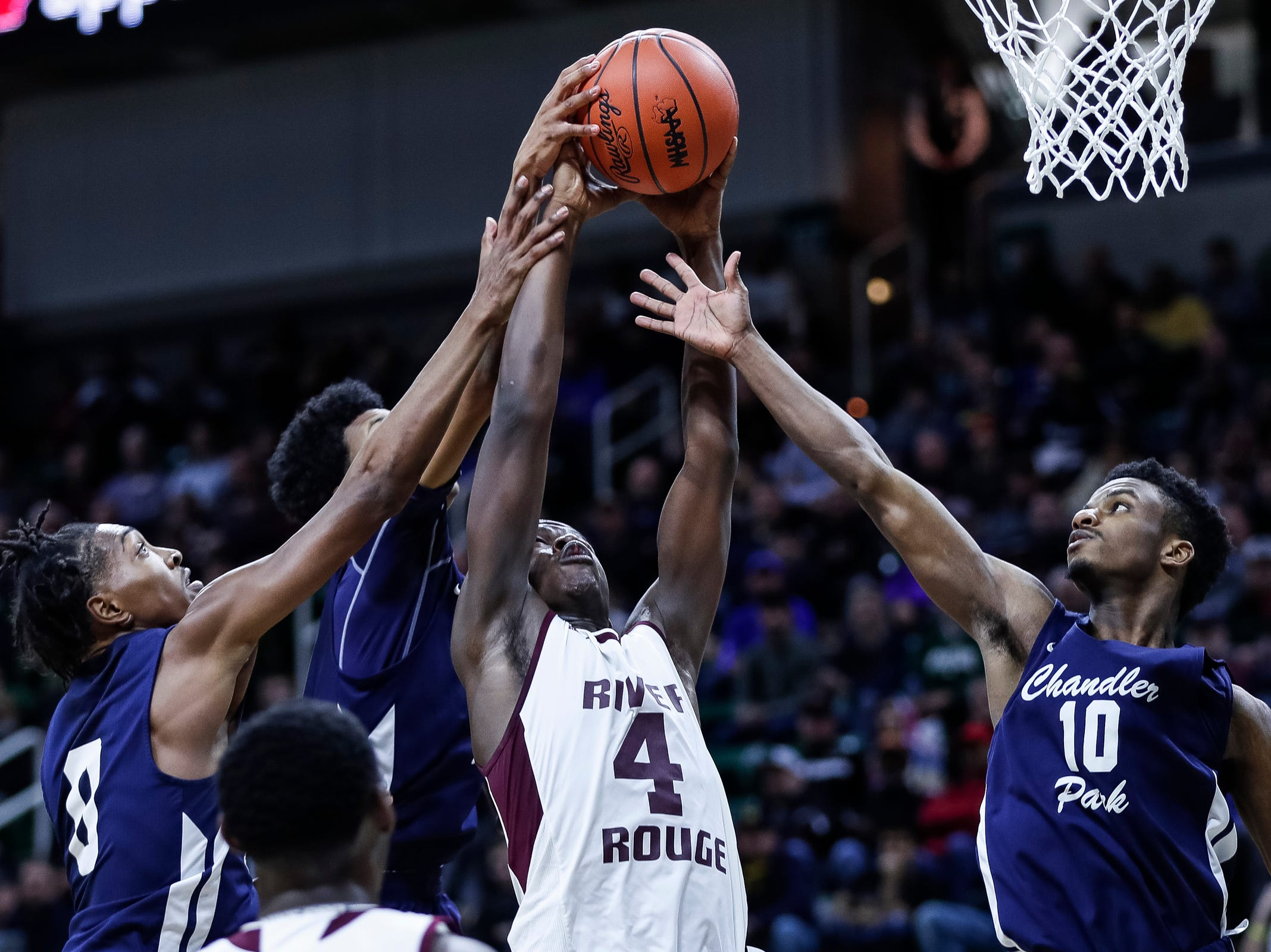 River Rouge's Legend Geeter (4) battles for a rebound during the second half of MHSAA Division 2 semifinal at the Breslin Center in East Lansing, Friday, March 15, 2019.