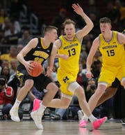 Michigan forward Ignas Brazdeikis defends against Iowa guard Joe Wieskamp during second half action of the Big Ten tournament Friday, March 15, 2019, at the United Center in Chicago, Ill.