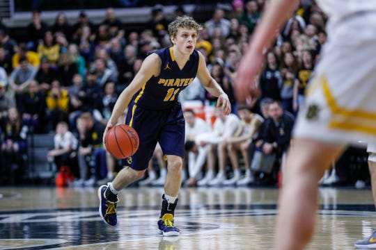 Pewamo-Westphalia's Collin Trierweiler (11) dribbles against Iron Mountain during the second half of MHSAA Division 3 final at the Breslin Center in East Lansing, Saturday, March 16, 2019.