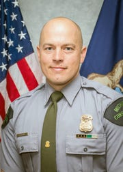 Michigan Department of Natural Resources Conservation Officer Kevin Postma