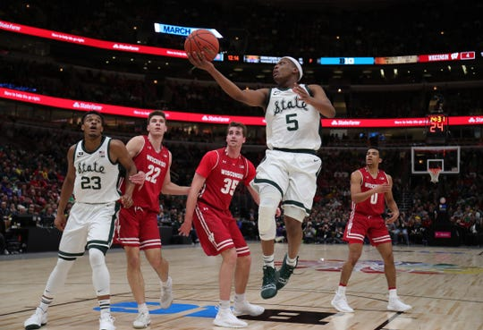 Michigan State Guard Cassiuis Winston scores against Wisconsin defenders during the first half action of the Big Ten tournament semifinals Saturday, March 16, 2019 at the United Center in Chicago.