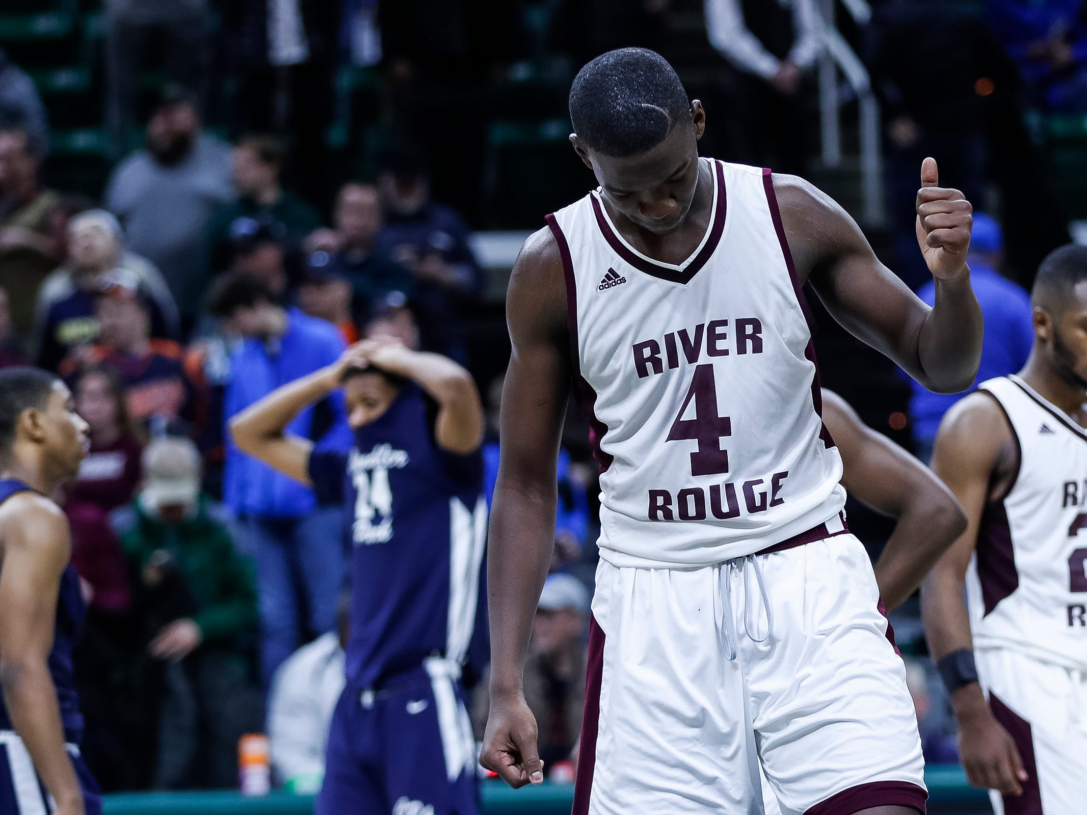 River Rouge's Legend Geeter (4) gives a thumb up as he waits for the last seconds of the game to expire in overtime win over Harper Woods Chandler Park at MHSAA Division 2 semifinal at the Breslin Center in East Lansing, Friday, March 15, 2019.
