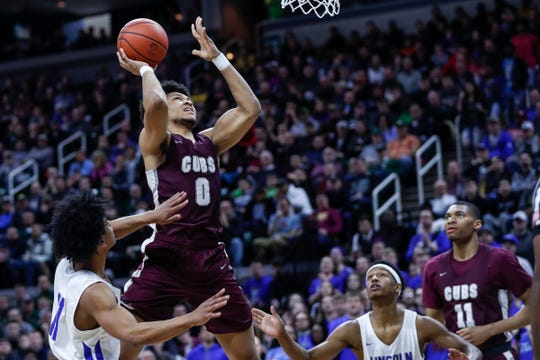 U-D Jesuit's Daniel Friday (0) makes a jump shot against Ypsilanti Lincoln during the first half of MHSAA Division 1 final at the Breslin Center in East Lansing, Saturday, March 16, 2019.