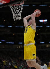 Michigan forward Ignas Brazdeikis scores against Minnesota during the first half of the Big Ten tournament semifinal Saturday, March 16, 2019 at the United Center in Chicago.
