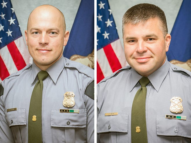 Michigan Department of Natural Resources Conservation Officer Kevin Postma, left, and Michigan Department of Natural Resources Conservation Officer Calvin Smith.