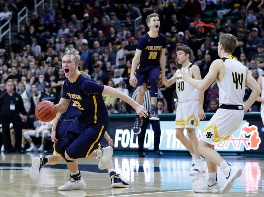 Pewamo-Westphalia players celebrate as the clock ticks down as they win the MHSAA Division 3 final at the Breslin Center in East Lansing, Saturday, March 16, 2019.