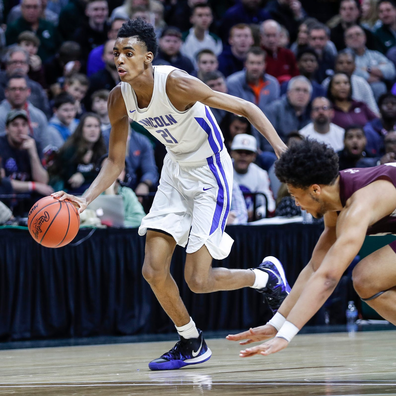 Ypsilanti Lincoln's Emoni Bates dribbles against U-D Jesuit's Daniel Friday during the first half of MHSAA Division 1 final at the Breslin Center in East Lansing, Saturday, March 16, 2019.