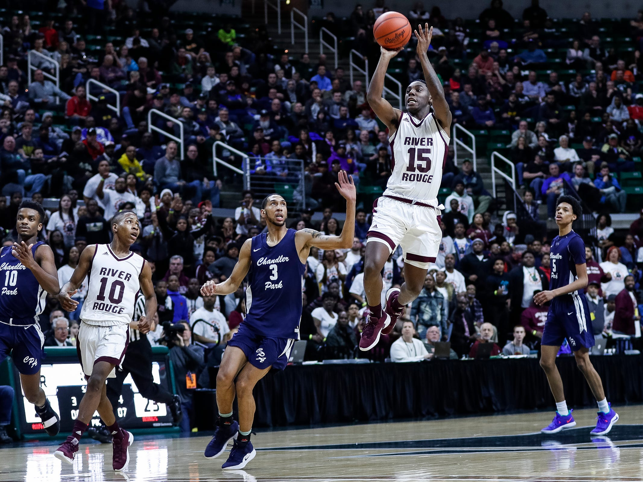 River Rouge's Kamal Hadden (15) makes a jump shot against Harper Woods Chandler Park in the last seconds of the first half of MHSAA Division 2 semifinal at the Breslin Center in East Lansing, Friday, March 15, 2019.