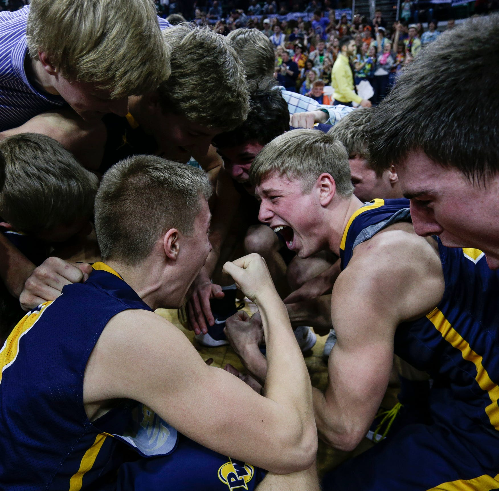 Pewamo-Westphalia players celebrate the Pirates' 53-52 win over against Iron Mountain during the second half of MHSAA Division 3 final at the Breslin Center in East Lansing, Saturday, March 16, 2019.