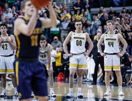 Iron Mountain players Jaden Vicenzi (42), Tony Feira (40), Foster Wonders (00) and Charlie Gerhard (44) watch Pewamo-Westphalia's Collin Trierweiler (11) makes a free throw in the last seconds of the second half of MHSAA Division 3 final at the Breslin Center in East Lansing, Saturday, March 16, 2019.
