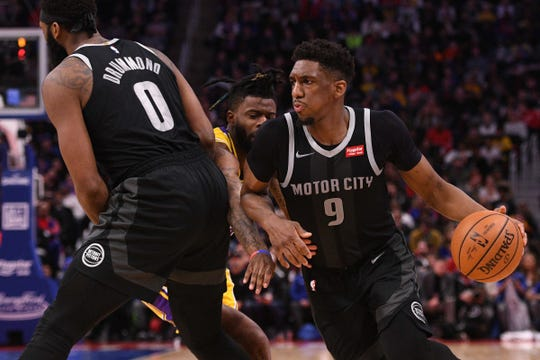 Langston Galloway drives to the basket as center Andre Drummond sets a pick on Lakers guard Reggie Bullock during the fourth quarter on Friday.