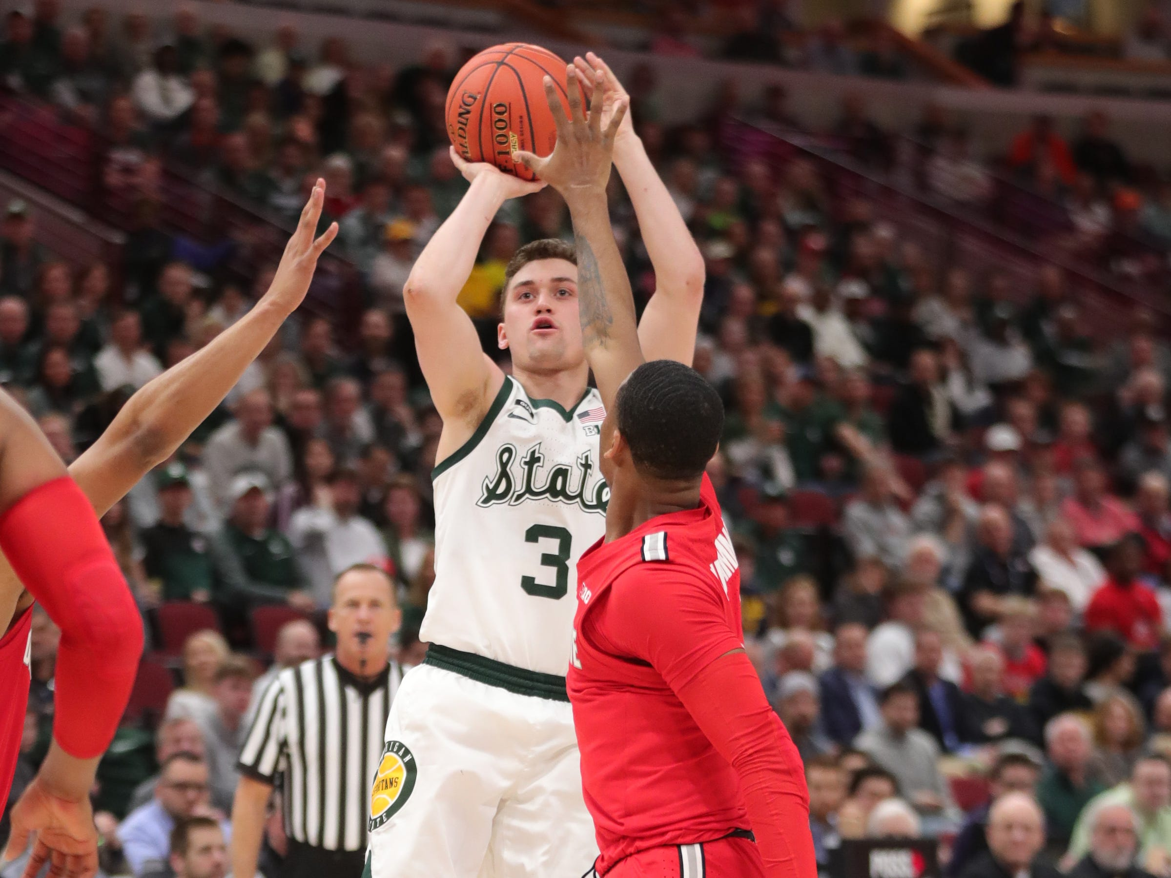 Michigan State's Foster Loyer scores against Ohio State during the second half of the Big Ten tournament Friday, March 15, 2019 at the United Center in Chicago.
