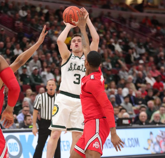 Foster Loyer scores against Ohio State on Friday in Chicago.