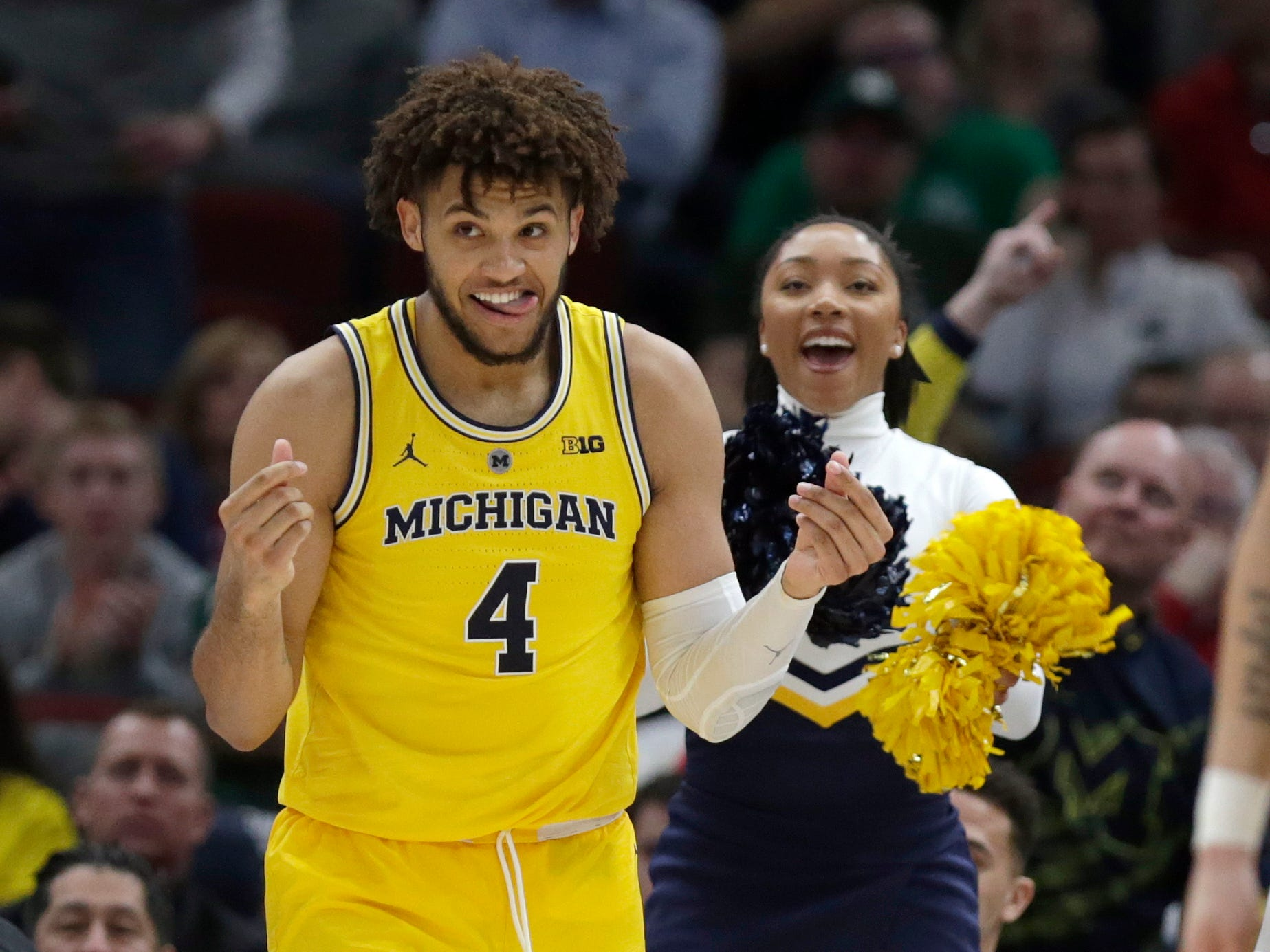 Michigan's Isaiah Livers reacts after making a shot during the second half.