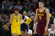 Michigan's Isaiah Livers reacts after making a shot during the second half. He finished with 21 points in the Wolverines' 76-49 victory Saturday.