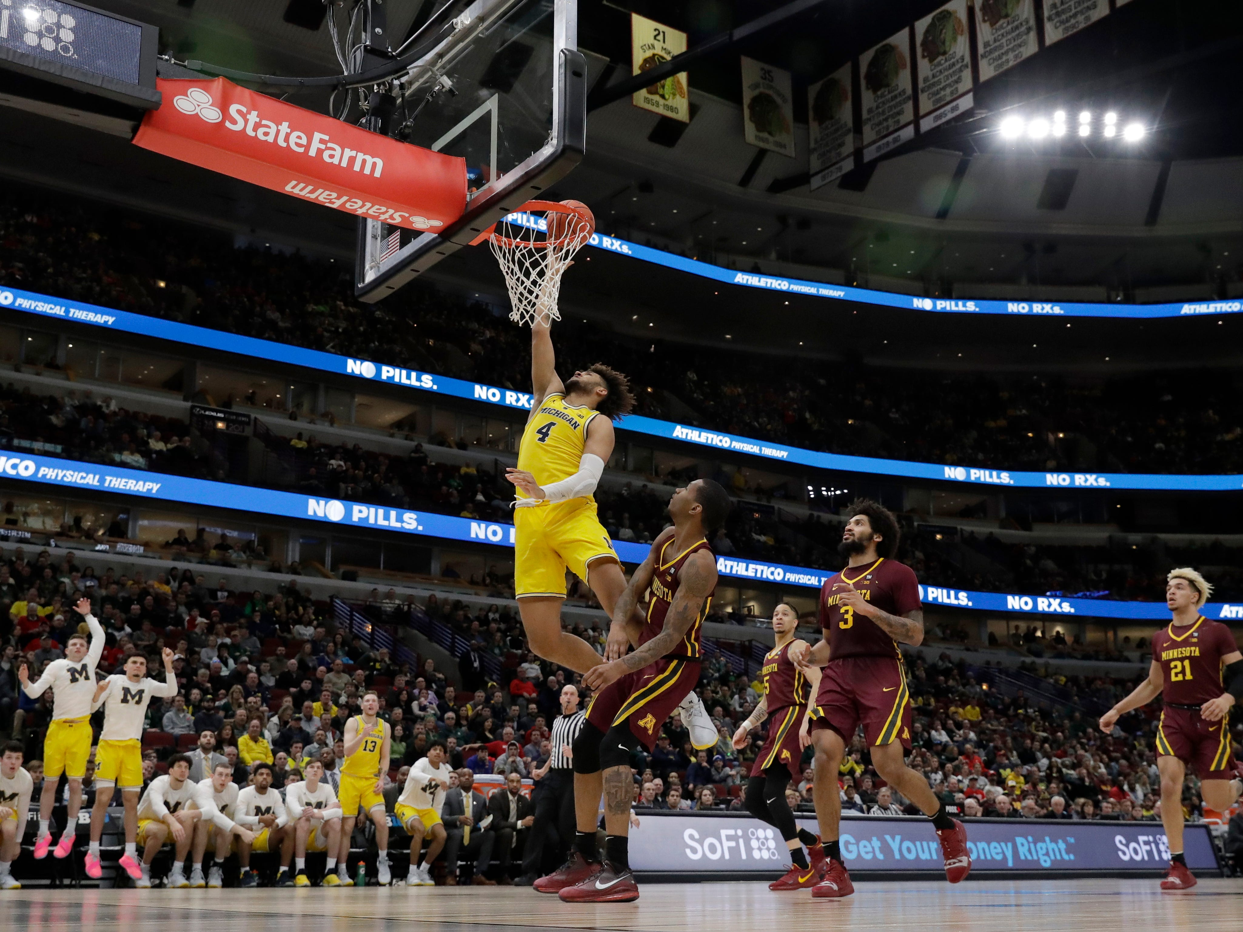 Michigan's Isaiah Livers goes up for a layup against Minnesota's Dupree McBrayer during the second half.