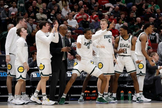 The Michigan State bench celebrates a a basket in the second half Friday.