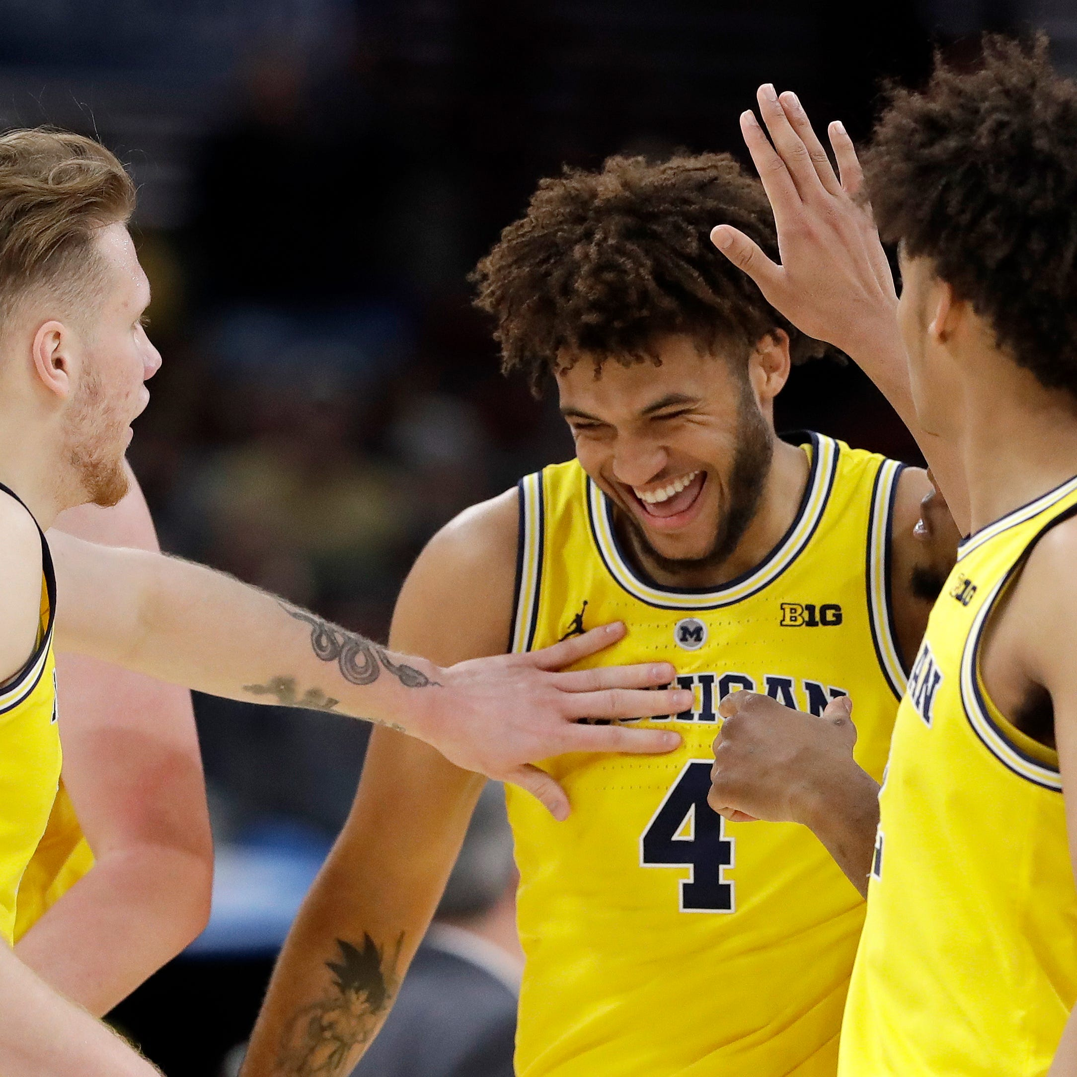 'We're having fun out there': Wolverines bury Gophers to make Big Ten title game