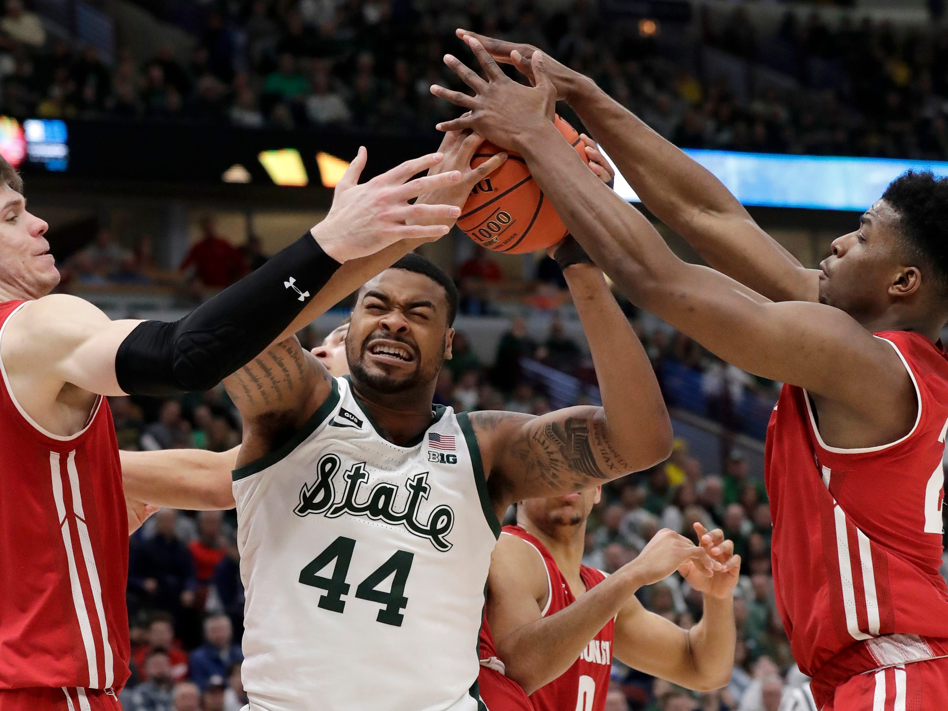 Michigan State's Nick Ward battles for a rebound against Wisconsin's Ethan Happ (22) and Aleem Ford during the second half.