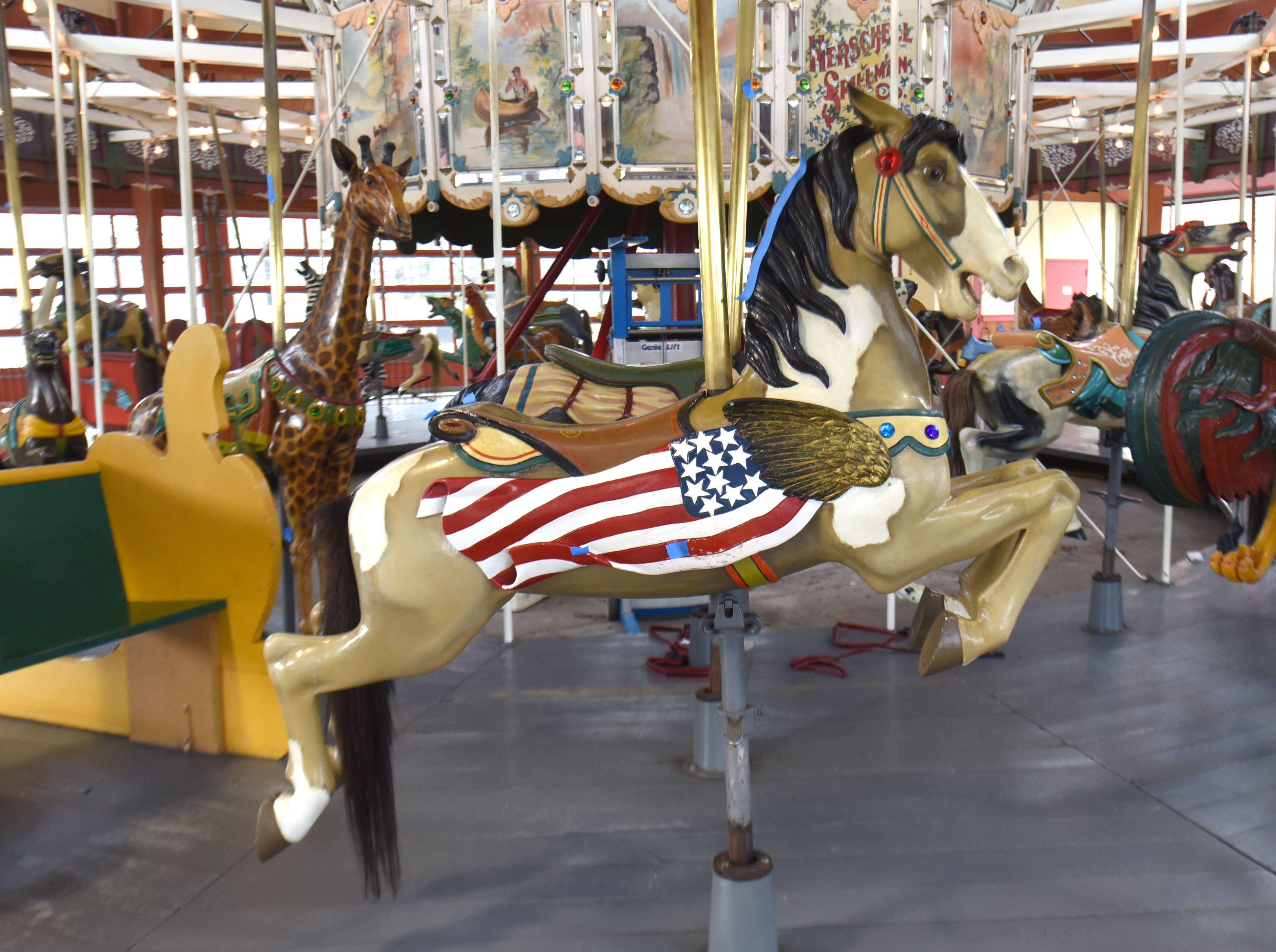 Julie Fournier, historic restoration artist,  works on the restoration carousel figures at Greenfield Village.