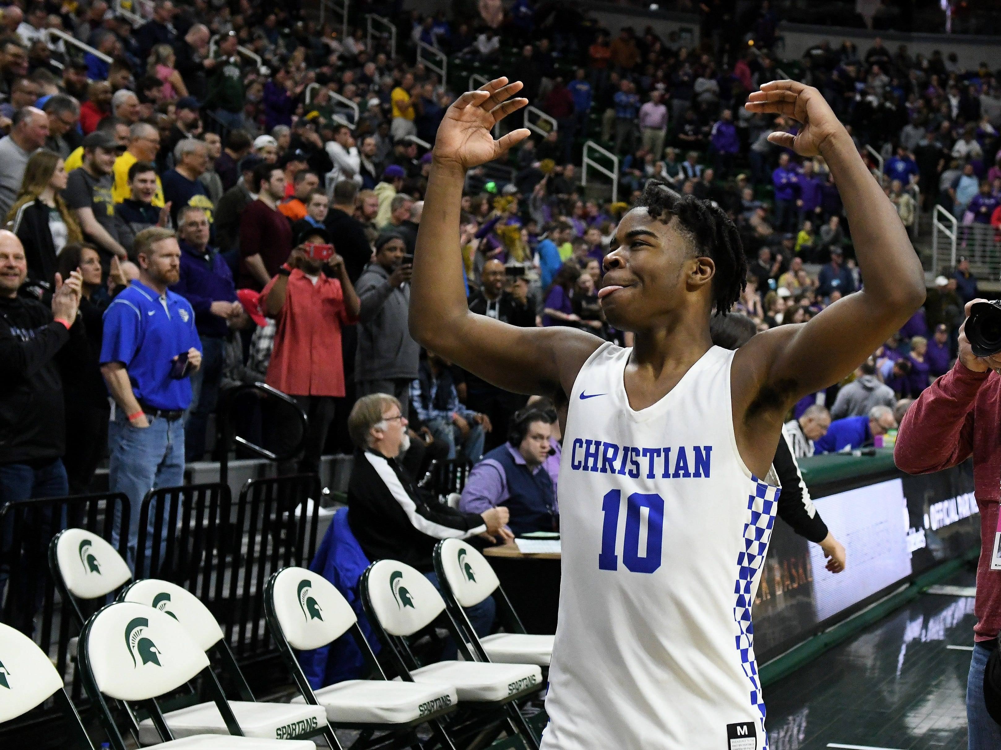 Southfield Christian guard Jon Sanders comes over to celebrate with the fans after the win.