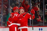 Red Wings center Andreas Athanasiou (72) celebrates his goal with Tyler Bertuzzi in the second period.