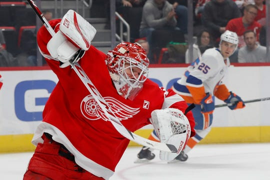 Detroit Red Wings goaltender Jonathan Bernier stops a New York Islanders shot in the first period.