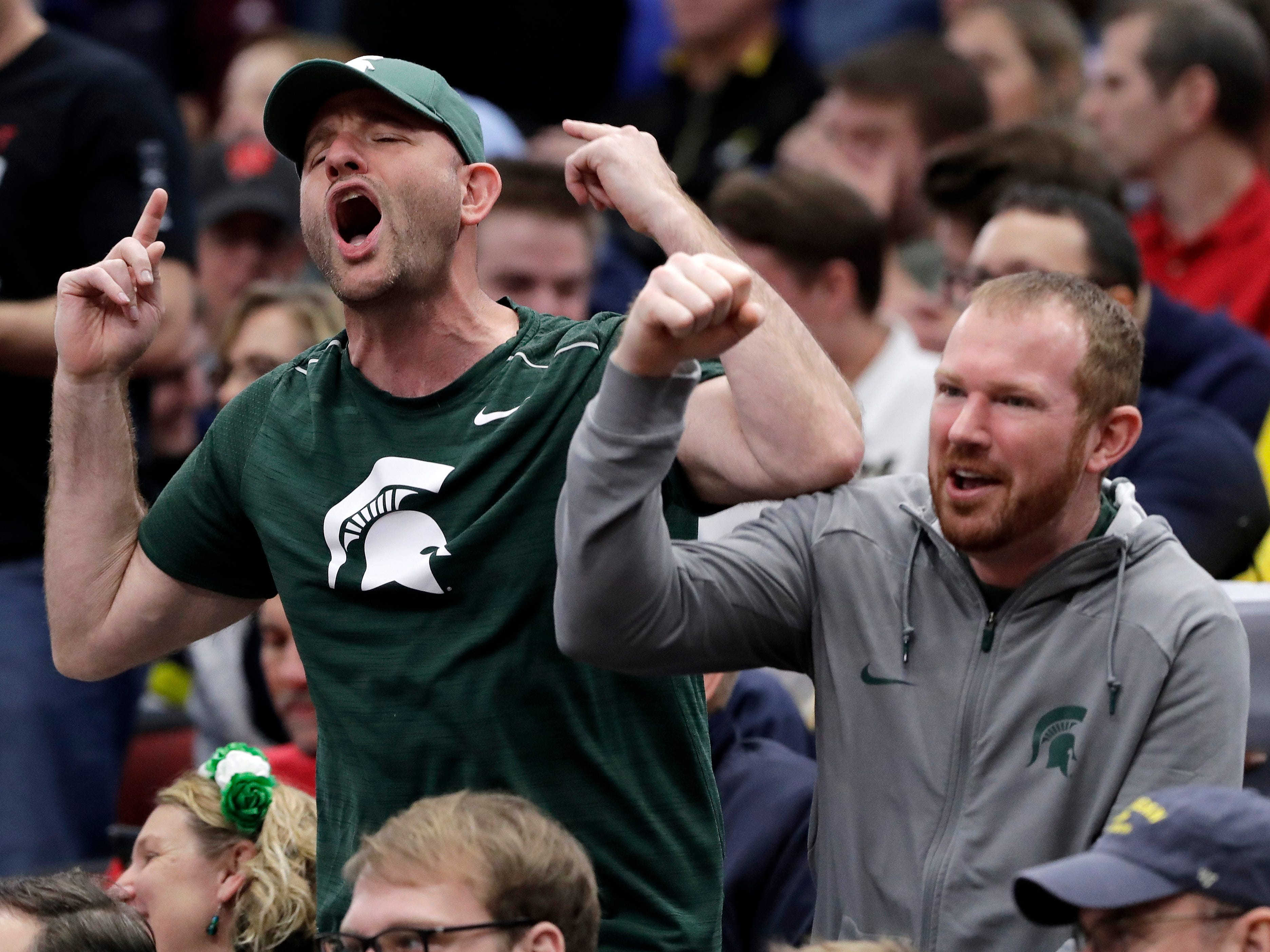 Michigan State fans cheer during the second half.
