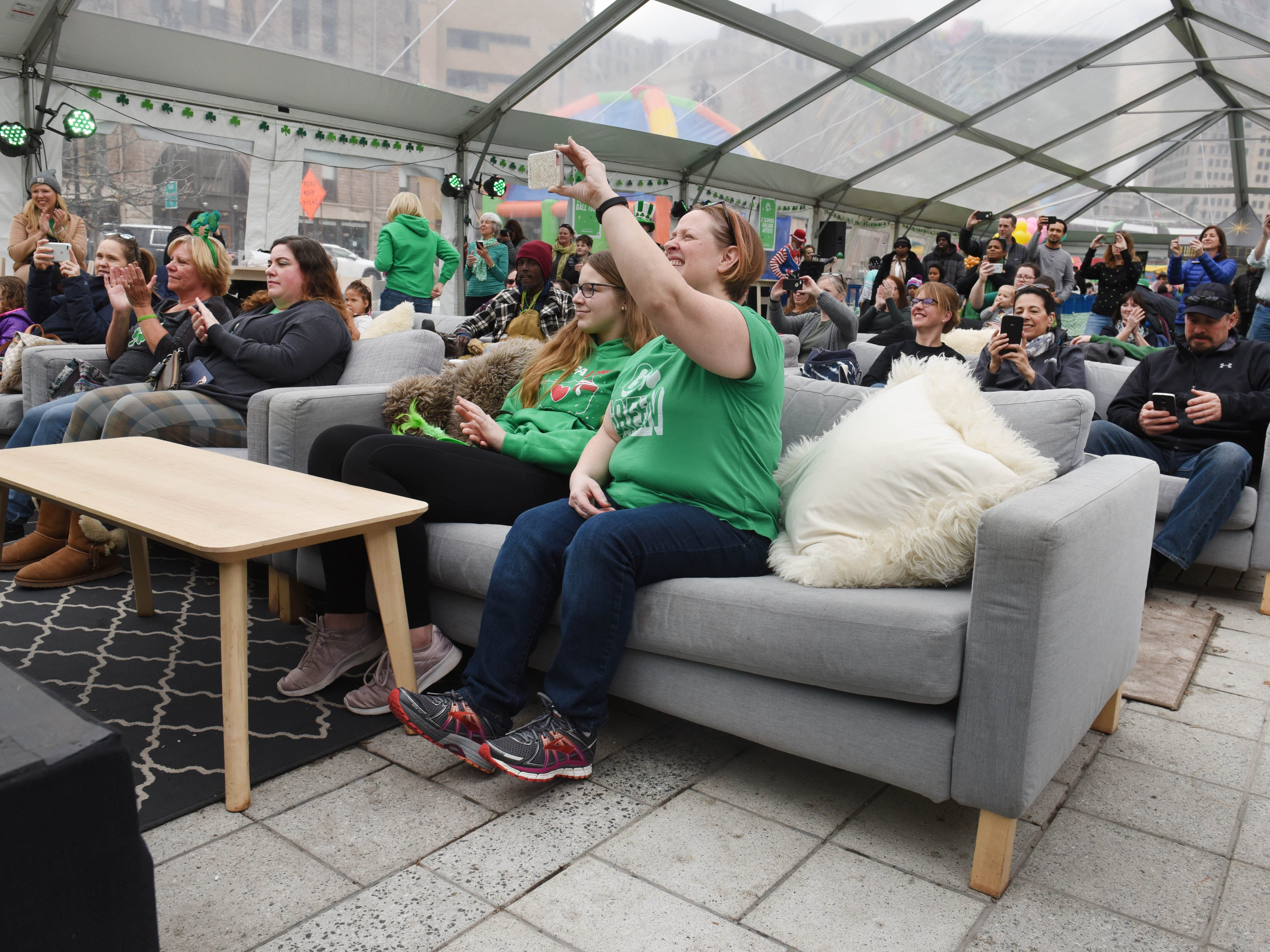 Family and friends sit inside a heated tent to watch the Tim O'Hare Irish Dance group.