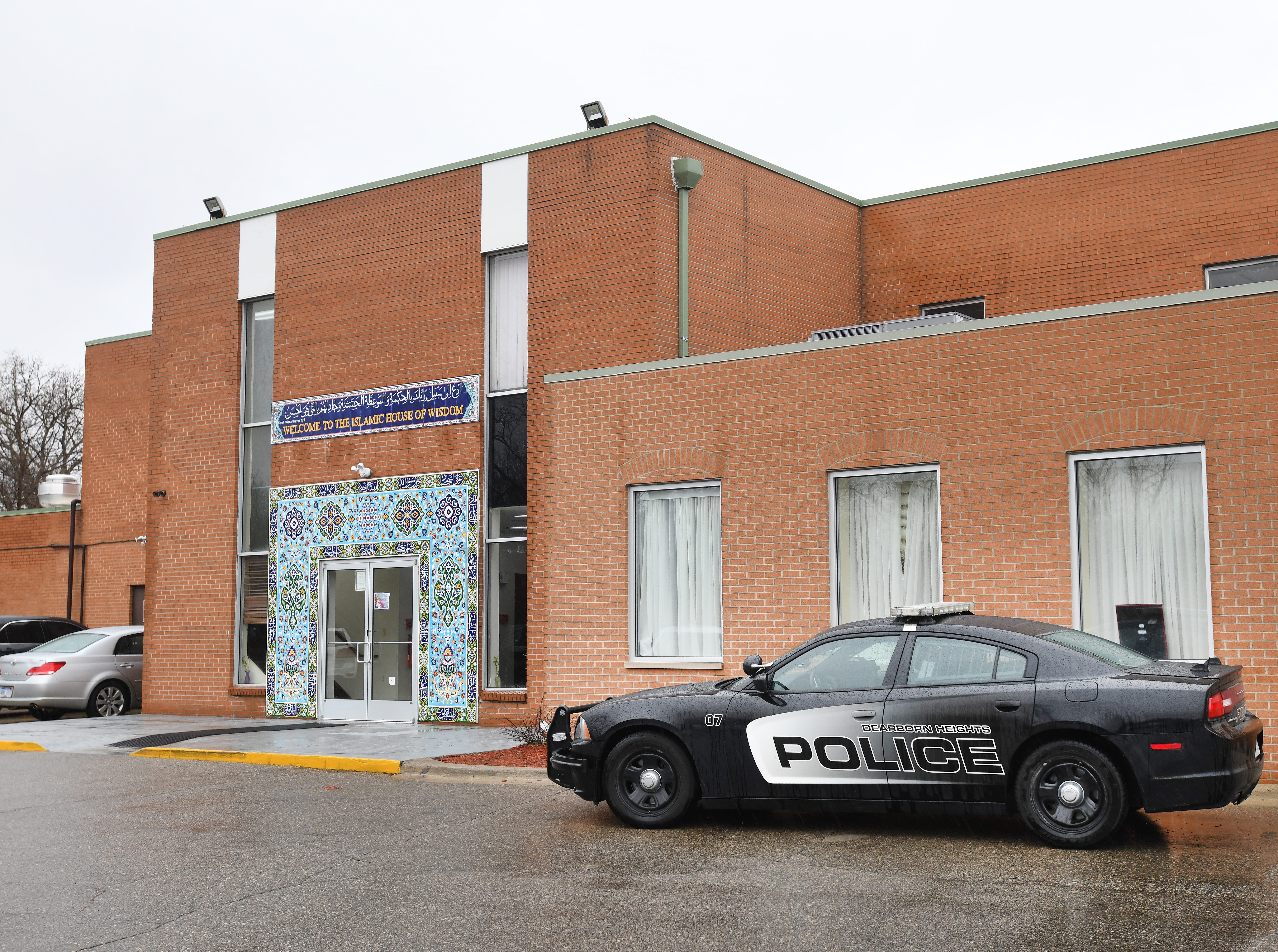 A Dearborn Heights police vehicle sits outside the Islamic House of Wisdom during a prayer service Friday afternoon.