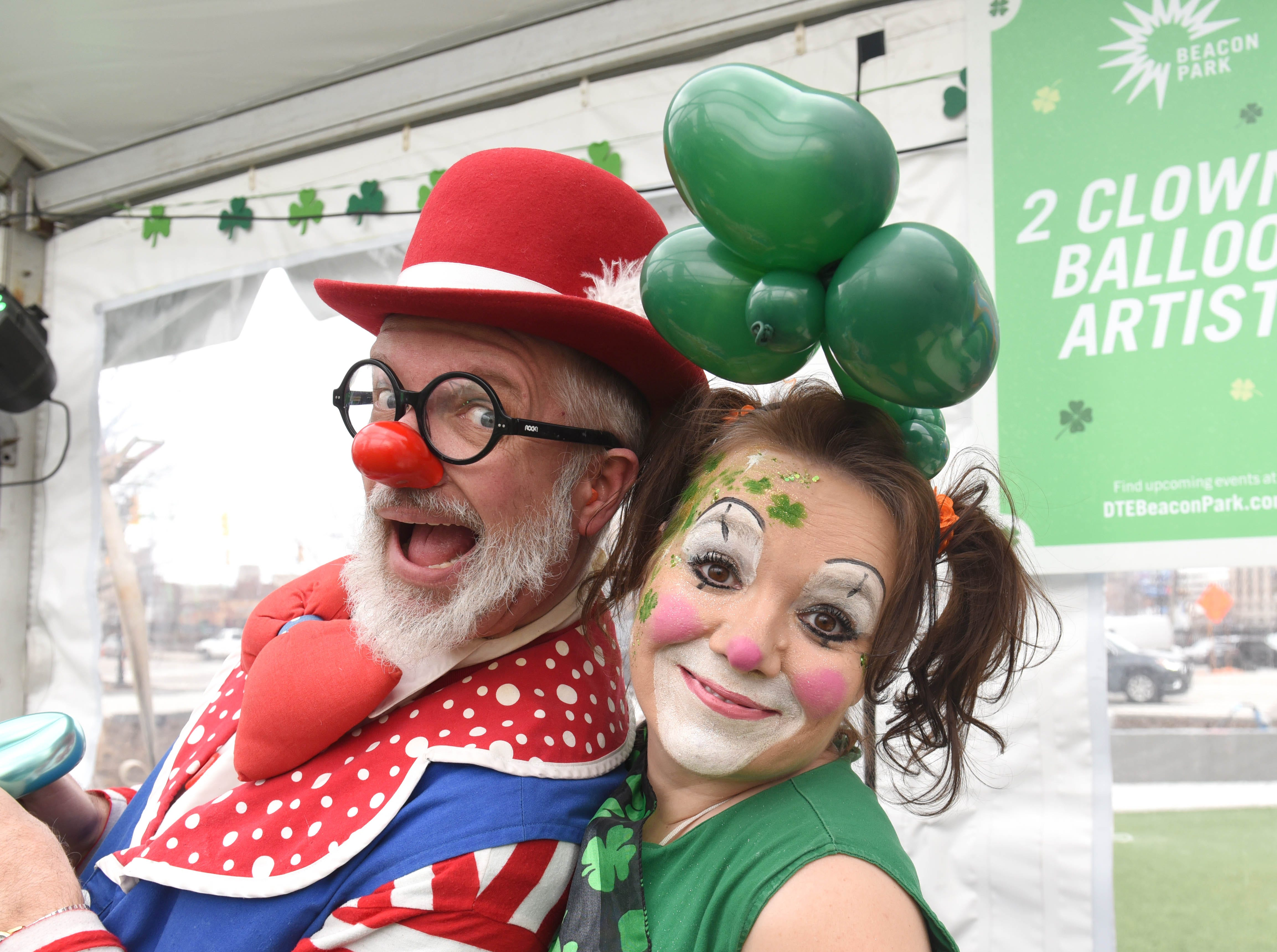 Dan Priest and his wife, Janice Priest, of 2Clowns.com, enjoy making balloon animals during the St. Patrick's Day Party at Beacon Park under a giant heated tent on Saturday, March 16, 2019.