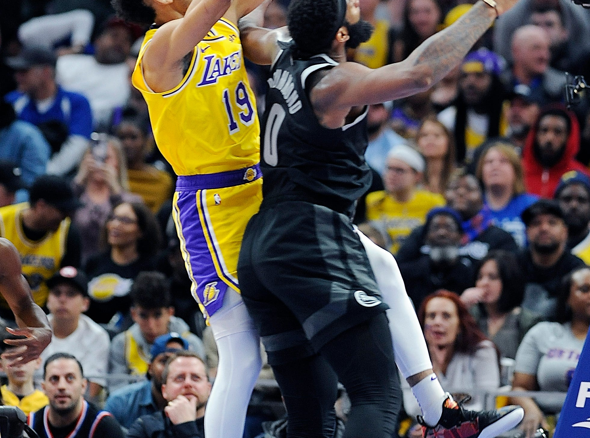 Pistons' Andre Drummond fouls Lakers' Johnathan Williams in the second quarter.