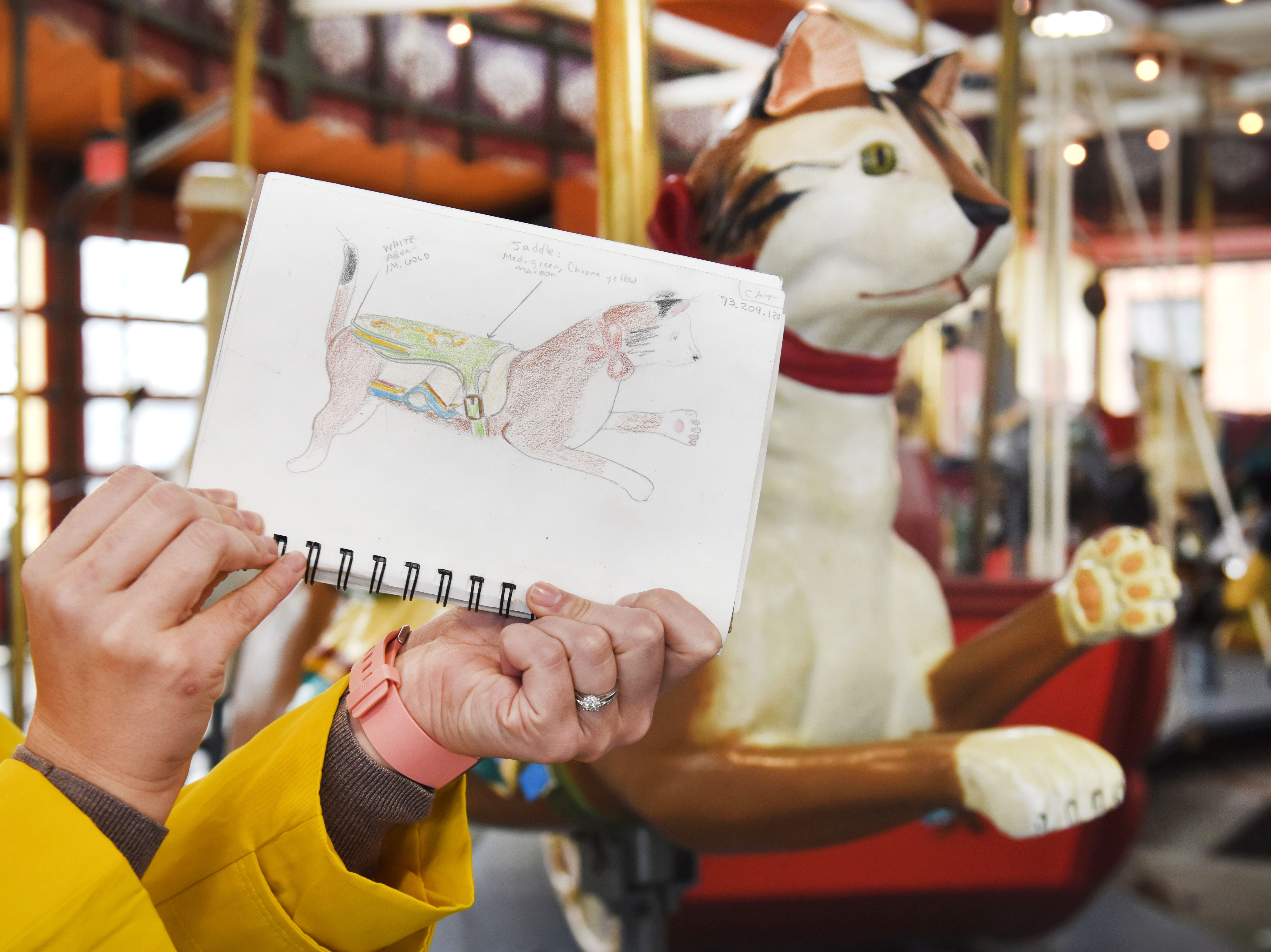 One of Julie Fournier's drawings matches the restored cat carousel figure at Greenfield Village in Dearborn.