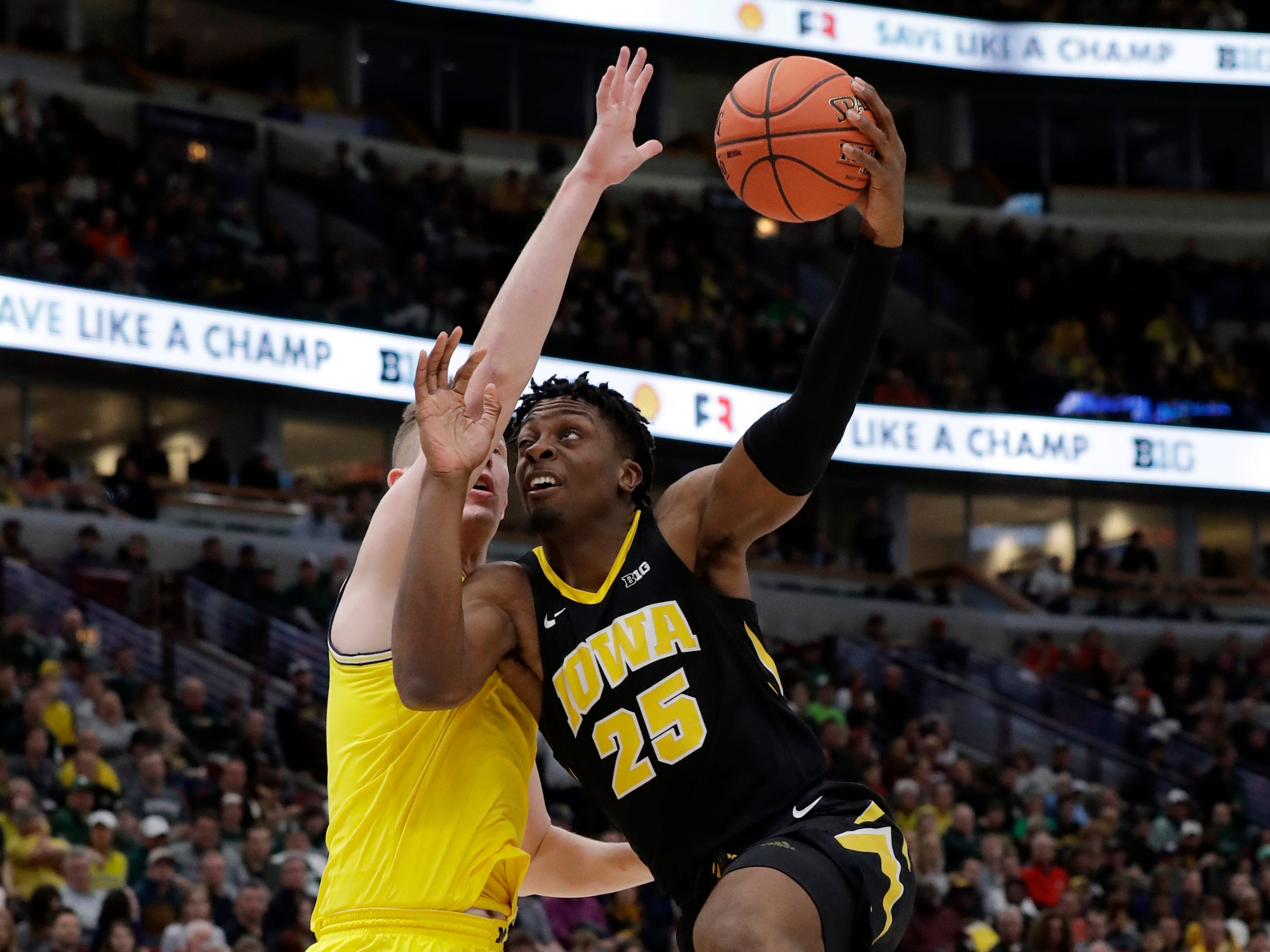 Iowa's Tyler Cook (25) goes up for a basket against Michigan's Jon Teske during the first half.