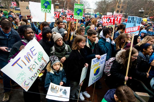 Protesters chant and cheer as they listen to speakers at the Washtenaw County Climate Strike on the University of Michigan Diag in Ann Arbor.