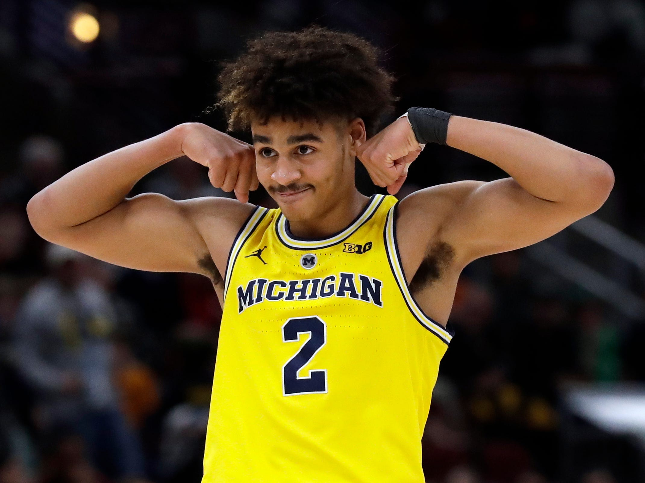 Michigan's Jordan Poole reacts after Eli Brooks scores a basket during the second half of a 76-49 Big Ten tournament semifinal victory over Minnesota on Saturday, March 16, 2019, at United Center in Chicago.
