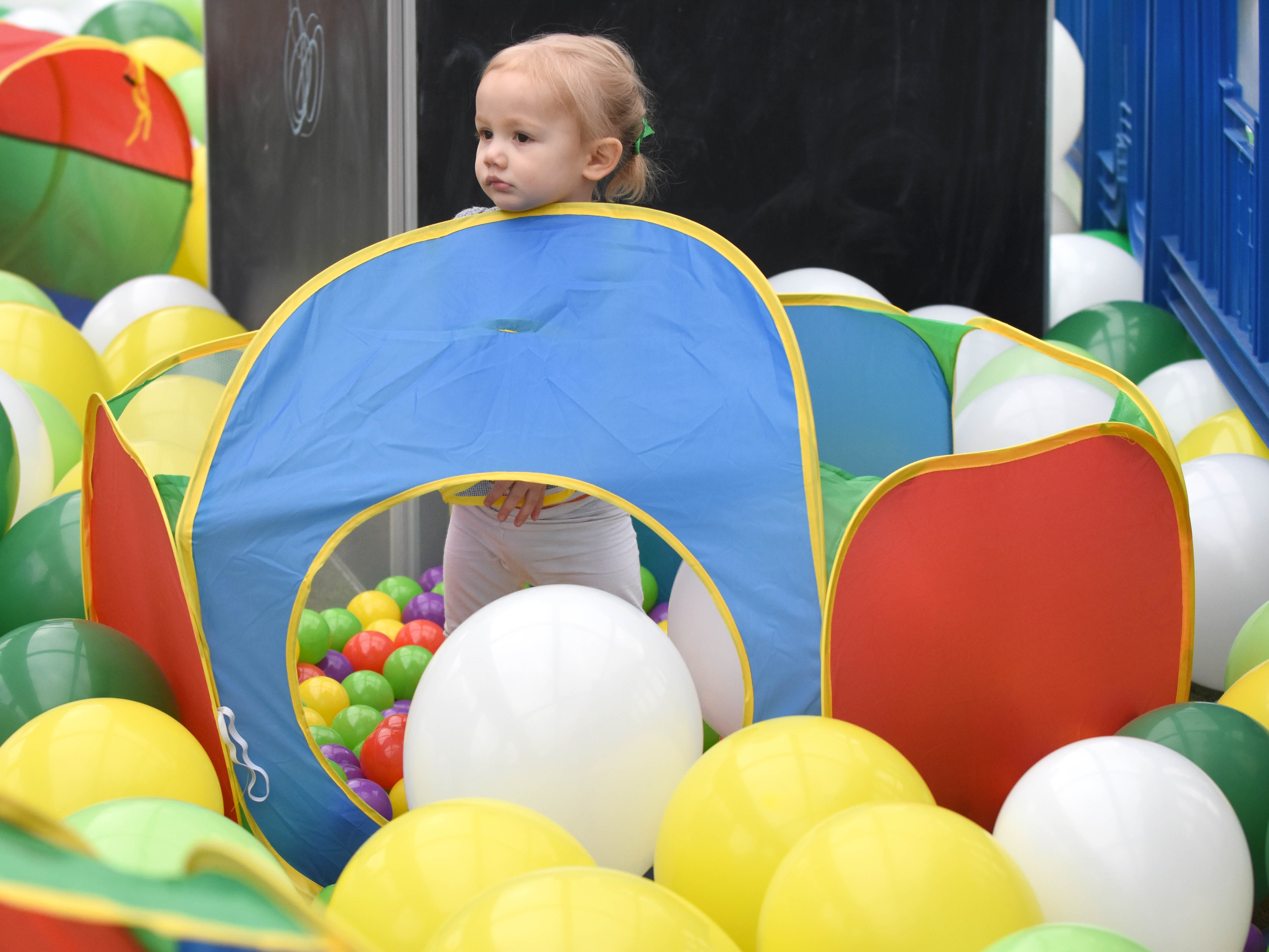 Elizabeth May, 2, of Milford, plays in a  balloon filled kid's activity section during the St. Patrick's Day Party.