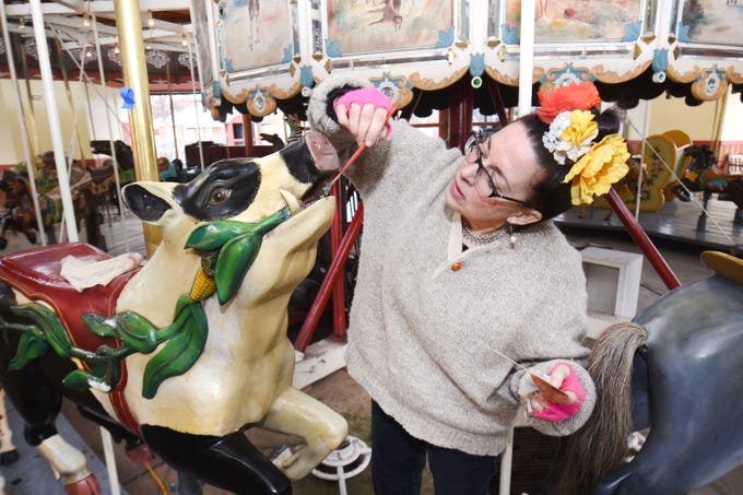 Julie Fournier, historic restoration artist,  works  on one of her favorite carousel  figure's during the restoration of the carousel at Greenfield Village in Dearborn on Thursday, March 14, 2019.