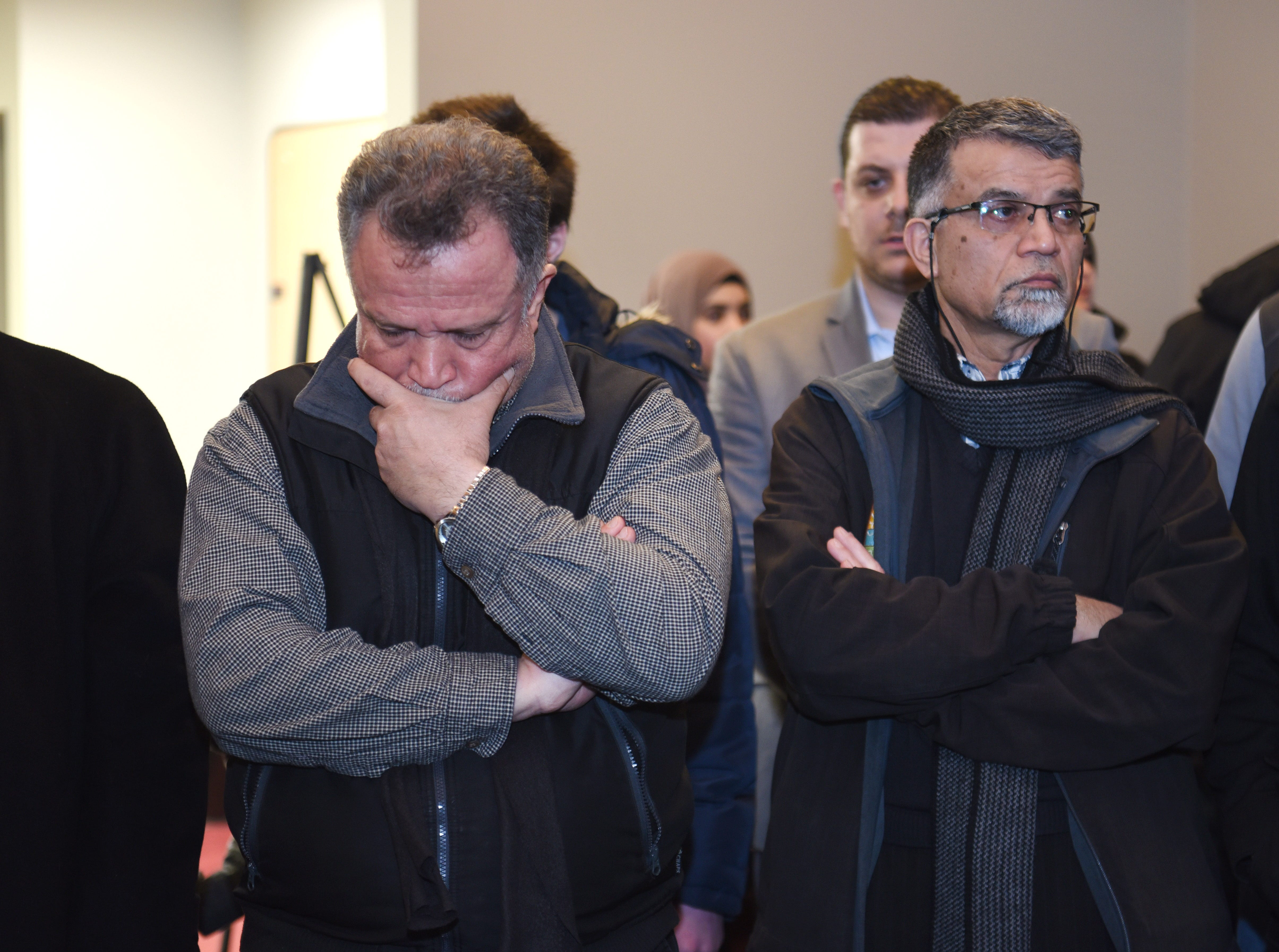 A member of the Islamic Institute of America grips his face as local Muslims pray during a  remembrance on Friday, March 15, 2019 for the lives lost in New Zealand.