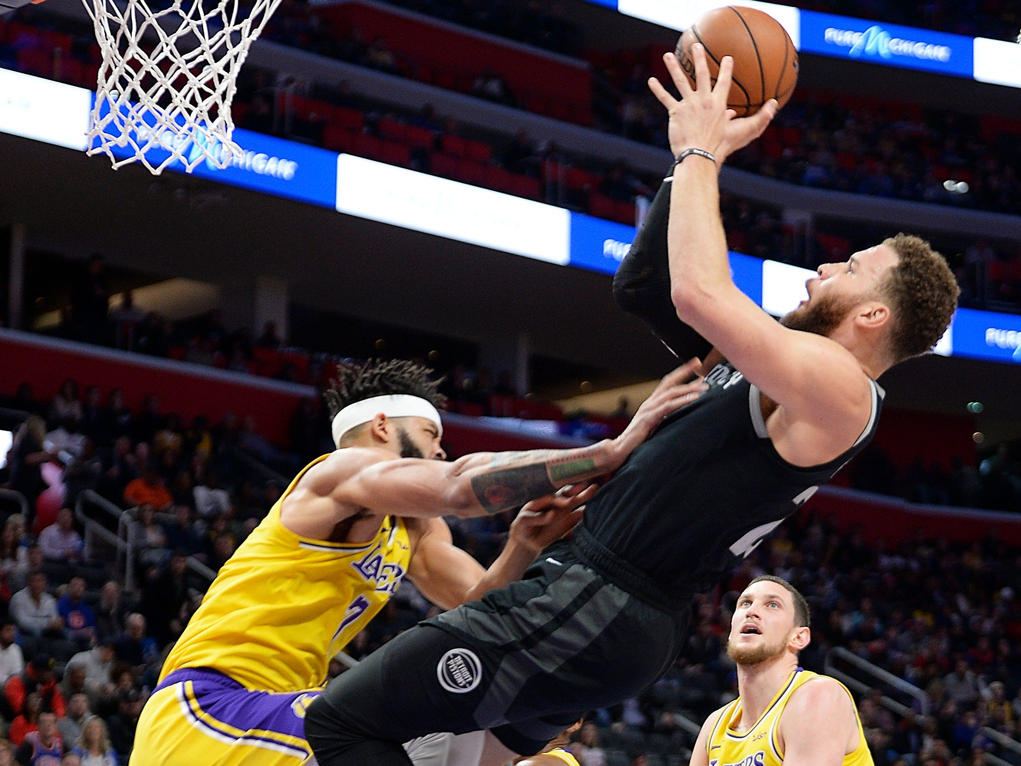 Pistons' Blake Griffin collides with Lakers' JaVale McGee while shooting in the first quarter. Griffin had 15 points and 9 assists.