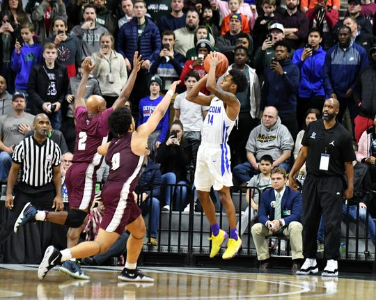 Ypsilanti Lincoln guard Jalen Fisher lets fly the winning shot in the Division 1 championship game Saturday.