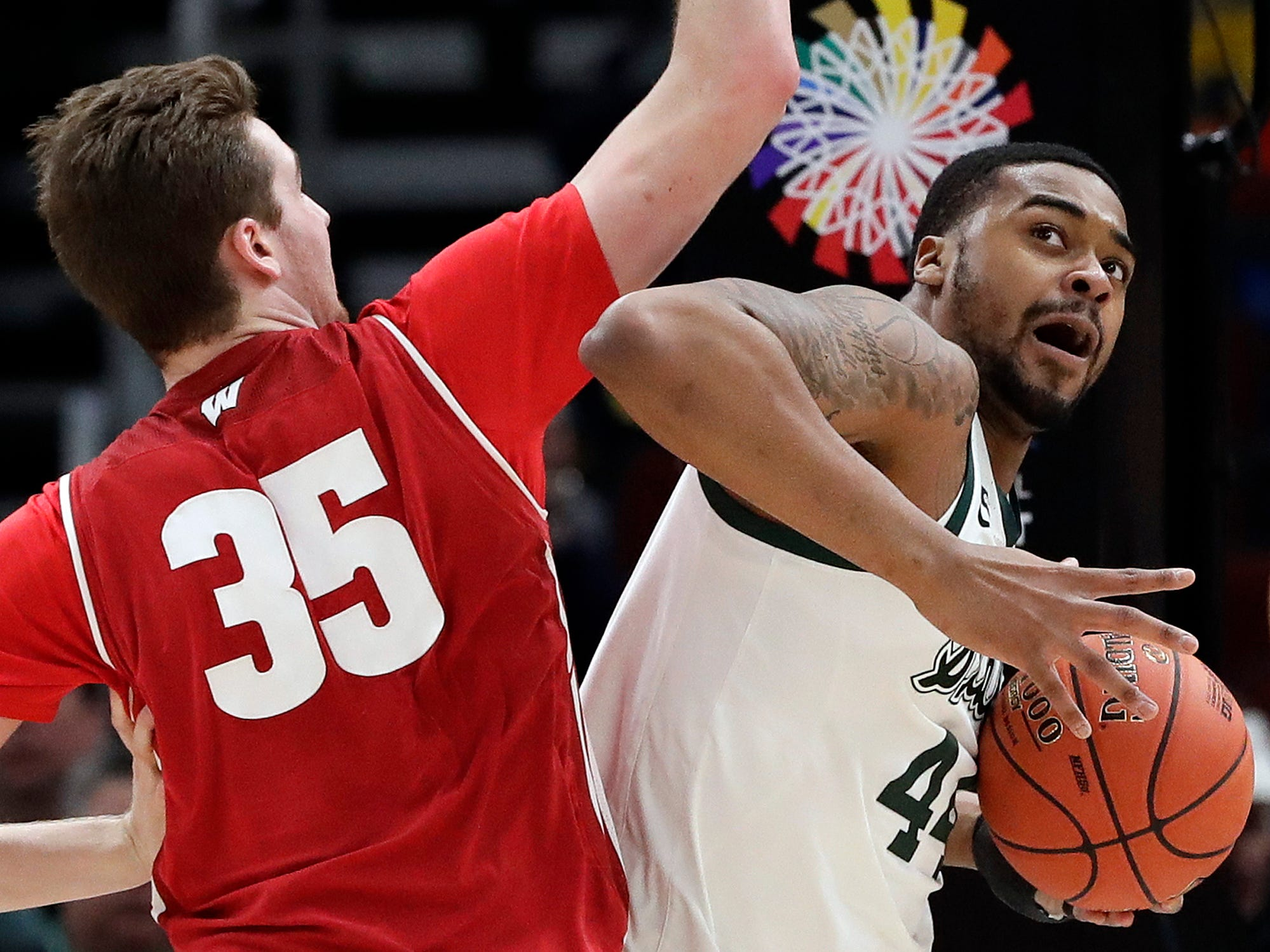 Michigan State's Nick Ward drives against Wisconsin's Nate Reuvers during the first half.