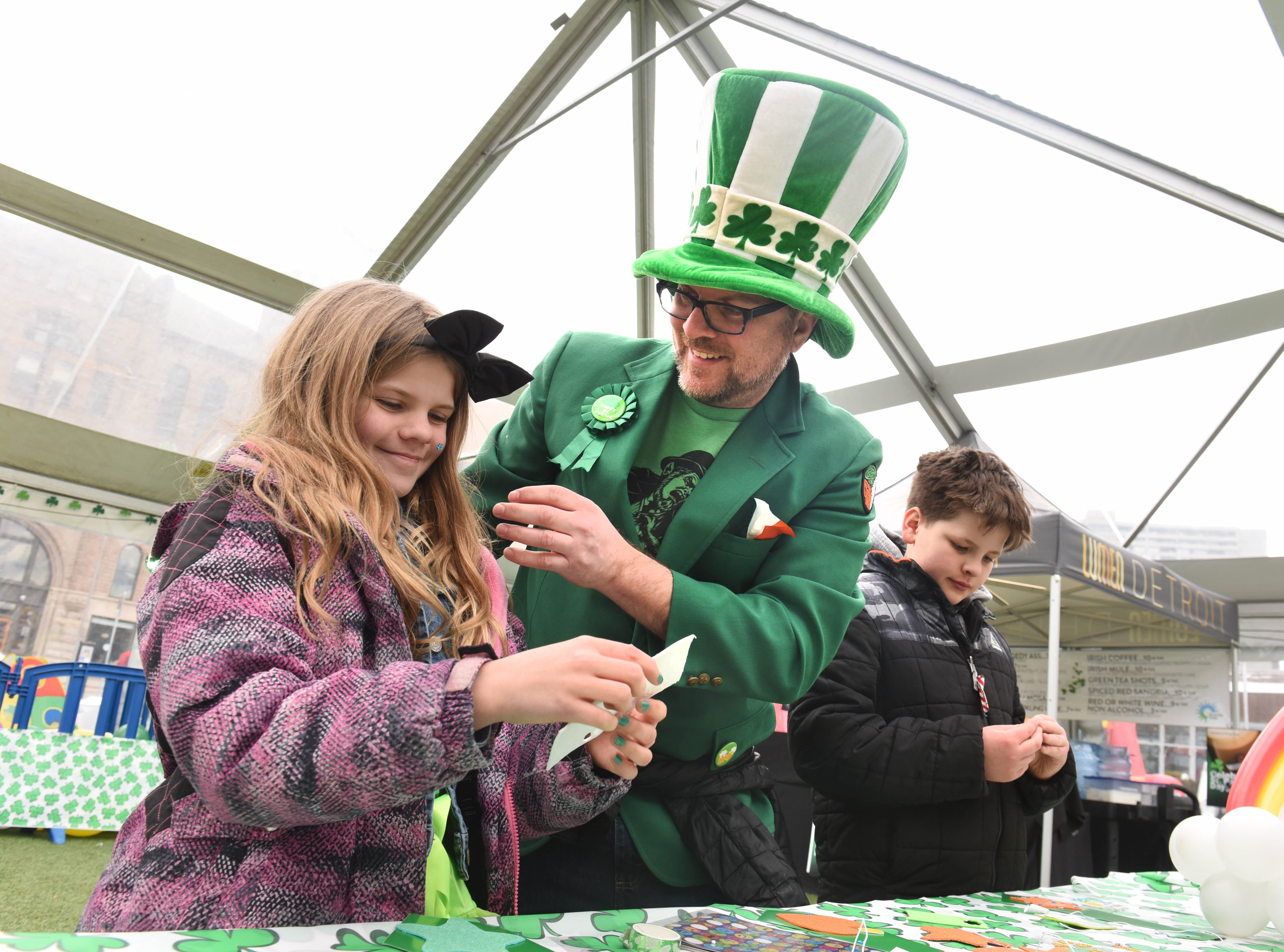 Scott Schommer, center, dressed head to toe in his best  St. Patrick's Day costume has fun with Madeline Schommer, left, and Lucas Schommer at the St. Patrick's Day Party at Beacon Park on Saturday, March 16, 2019.