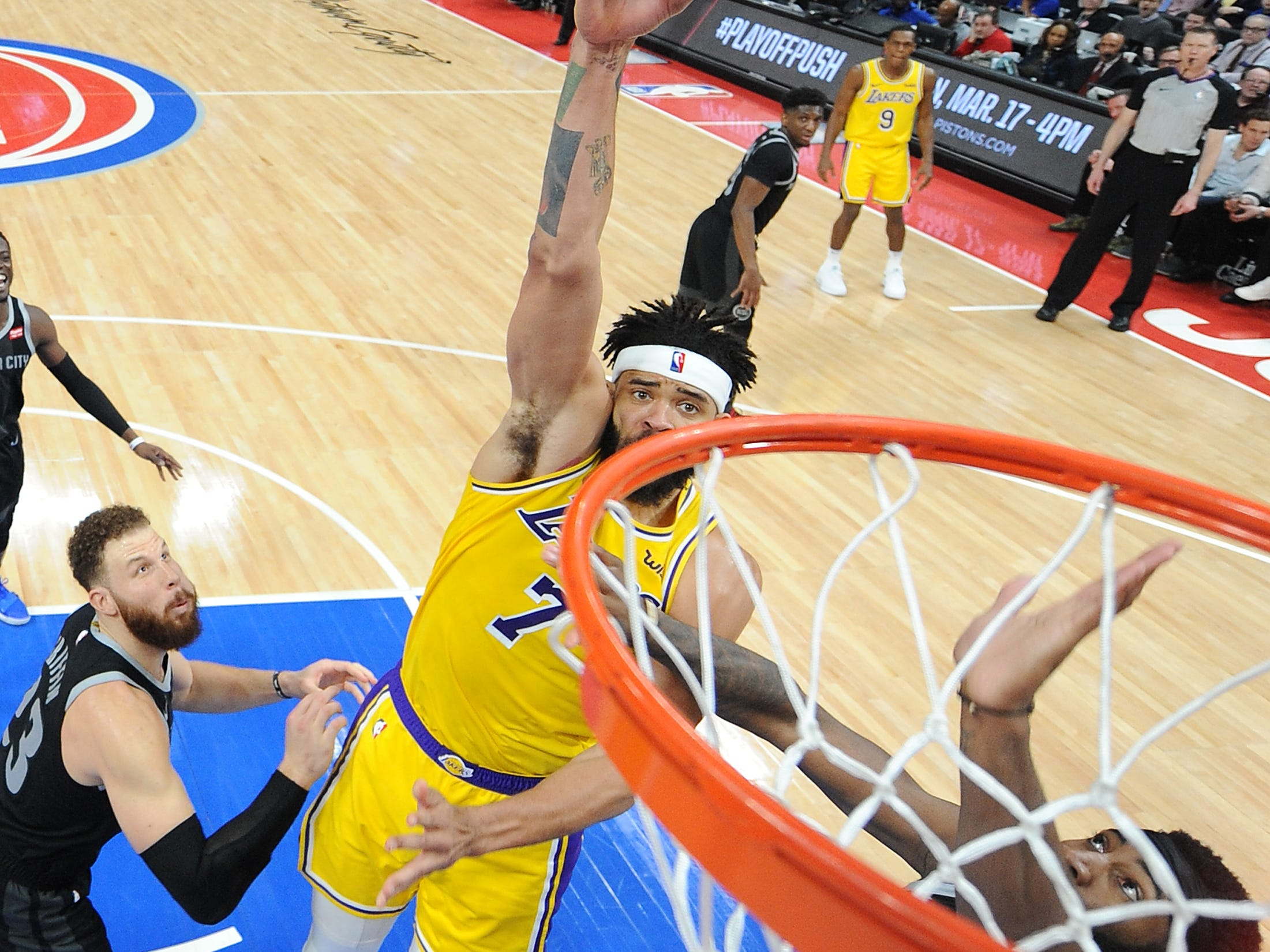 Lakers' JaVale McGee shoots over Pistons' Andre Drummond in the second quarter.